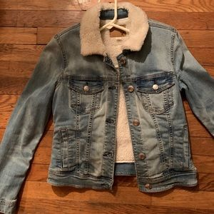 Sherpa lined jean jacket. New without tags.
